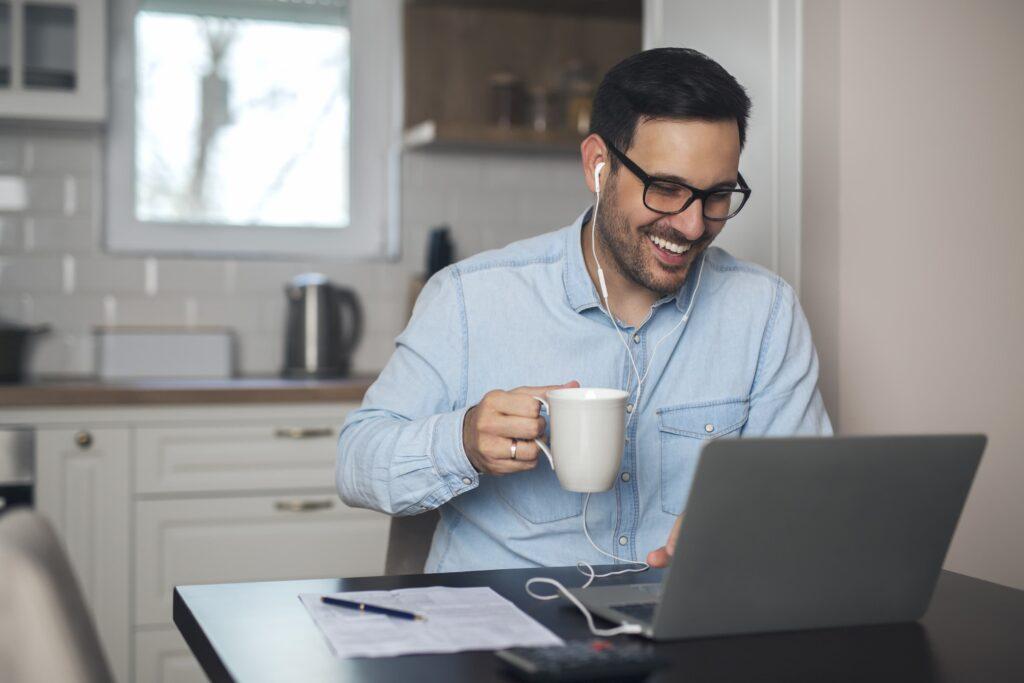 Man having video call on laptop