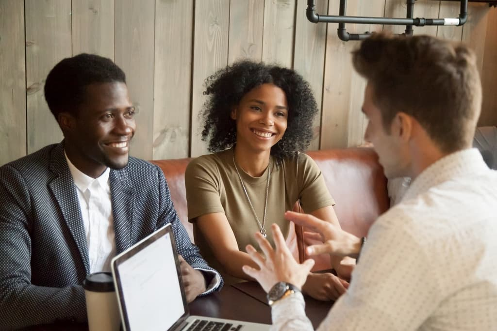 Couple talking to a trusted advisor