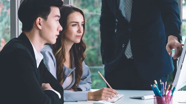 smart businessman and businesswoman_talking discussion in group meeting_at_office_table in a modern office interior business collaboration and strategic planning