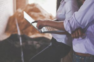 Senior Cloud Management Consultant discussing on laptop
