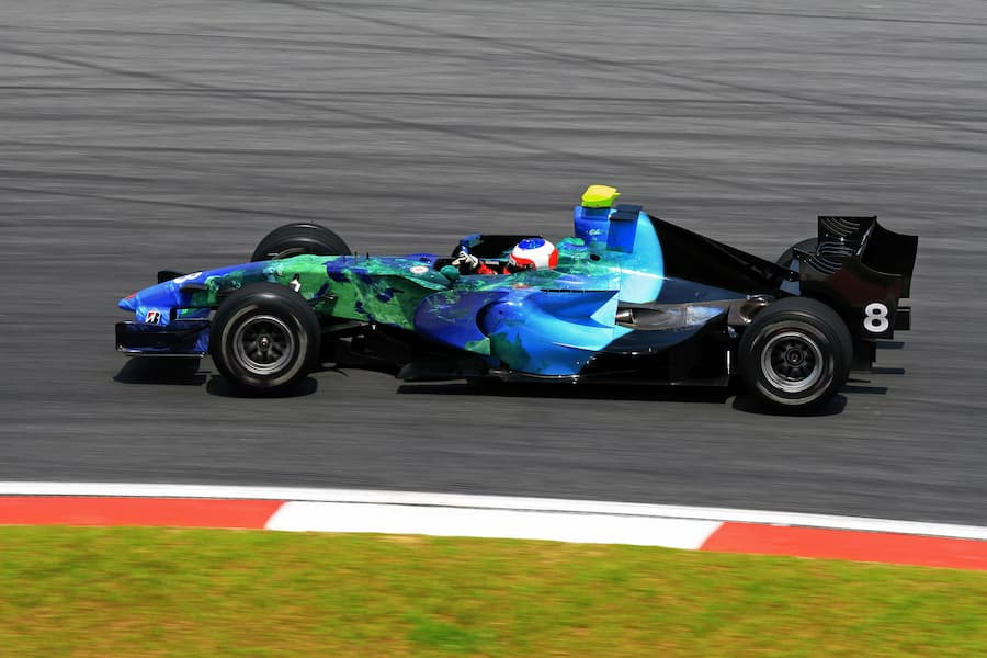 Green and Blue Formula 1 car on a race track
