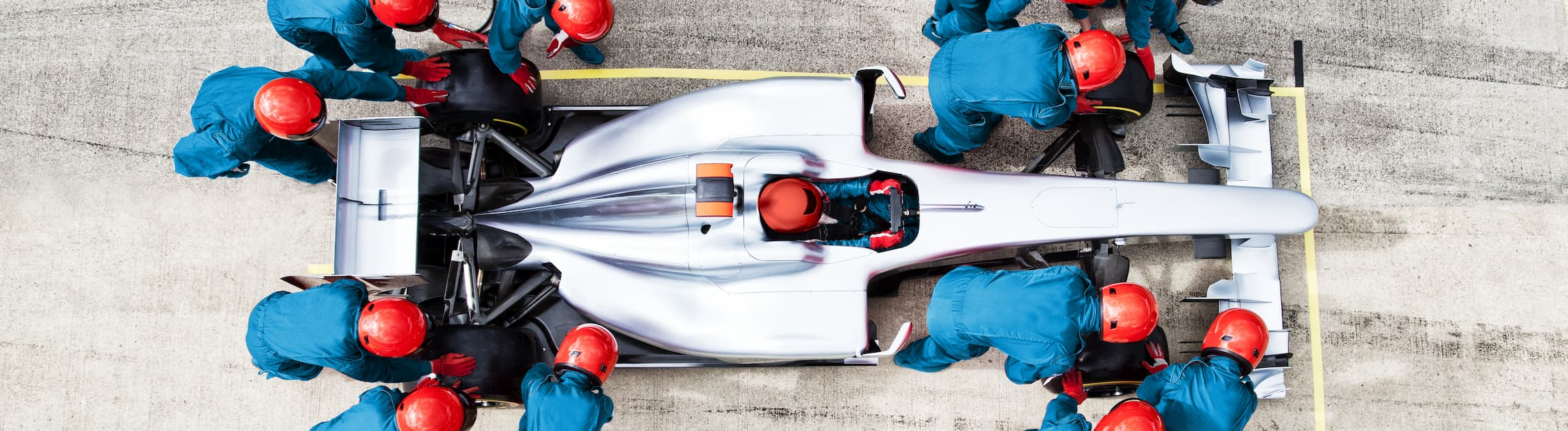 Pit crew attending all four corners of a Formula 1 car